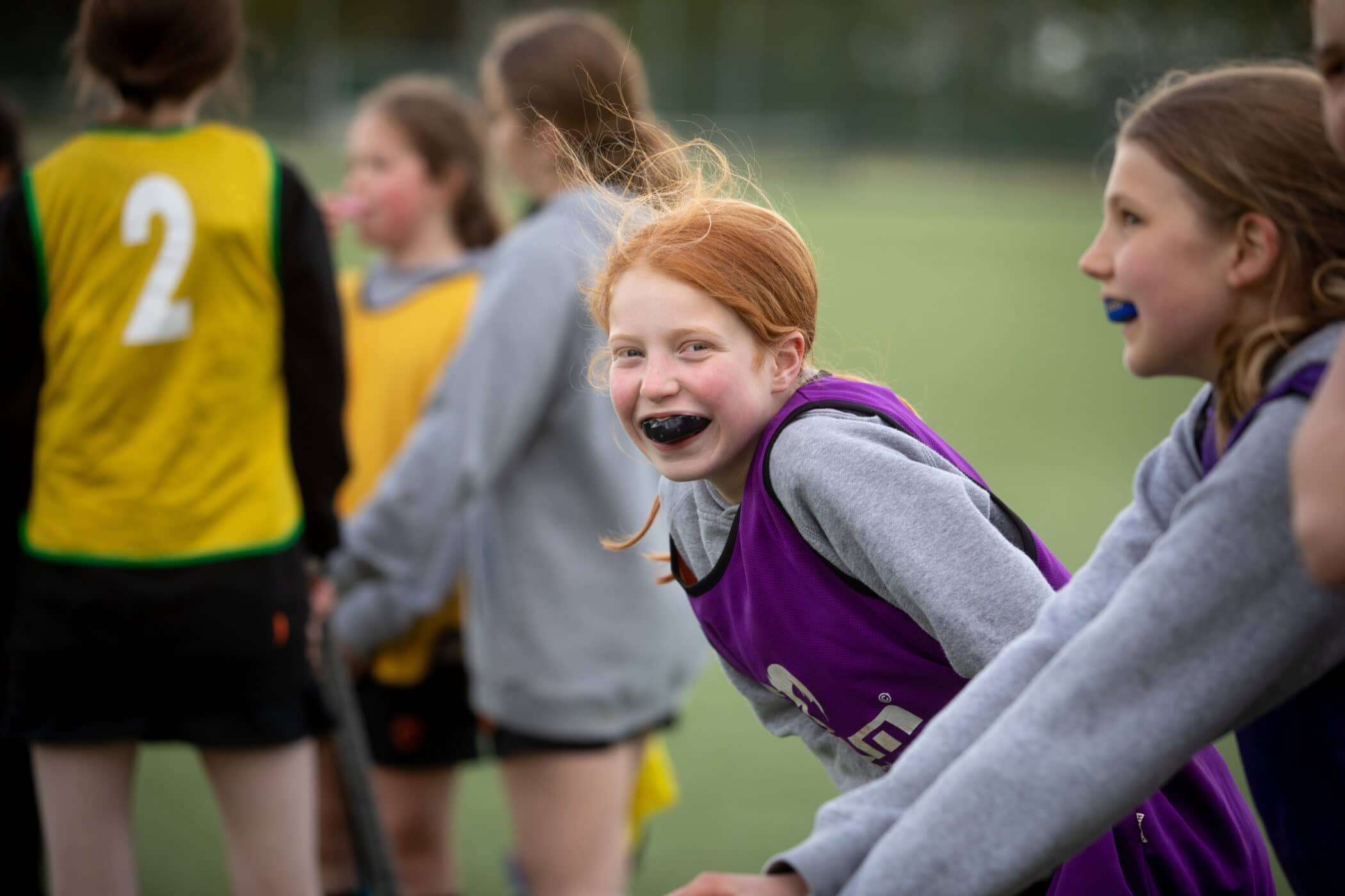 Smiling child with gumshield playing hockey